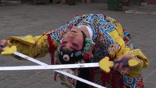 Actor Liu Zheng performs sword dance of heroine of FAREWELL MY CONCUBINE
