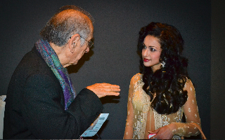 . Sikandar Sinha gestures hypnotically during discussion with enchanted actress Madhuri Bhattacharya