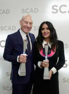 Actors Patrick Stewart and Salma Hayek with awards during the 20th Anniversary SCAD Savannah Film Festival