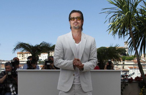 "Brad Pitt poses during the photocall of ""The Tree of Life"""