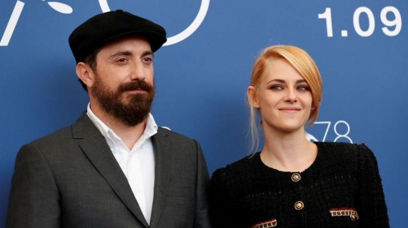 actor_kristen_stewart_and_director_pablo_larrain_pose_at_a_photo_call_at_the_venice_film_festival._reuters.jpg